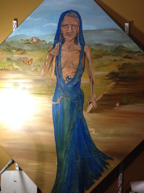 I have most of the color roughed in. Santa Muerte is finally emerging.